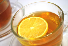 Tea with a lemon. Tea is poured in  cup, tea with a lemon, is isolated on white Royalty Free Stock Photography