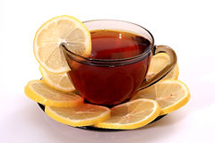 Tea with a lemon. Stock Images