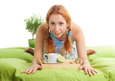 Tea with lemon in bed Royalty Free Stock Photo