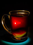 Tea with lemon. On a black background Stock Image
