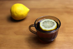 Tea with lemon. Black tea in cup with lemon royalty free stock photos
