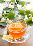 Tea with lemon and branches of a blooming jasmine Royalty Free Stock Photos