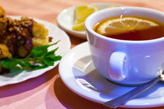 Tea with lemon and cakes Stock Photography
