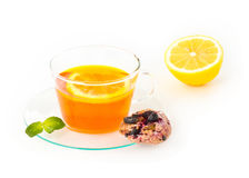Tea with lemon, cookie and mint on white backgroun Royalty Free Stock Photo