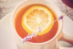 Tea with lemon in a cozy atmosphere. Selective focus Stock Photos