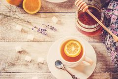 Tea with lemon in a cozy atmosphere. Selective focus Royalty Free Stock Photography