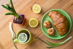 Tea with lemon and croissant for fresh spring breakfast Royalty Free Stock Photography
