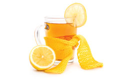 Tea with lemon cup wrapped in scarf Stock Photo