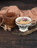 Tea with  lemon and dried flowers on the table Royalty Free Stock Photos