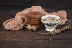 Tea with  lemon and dried flowers on the table Stock Image