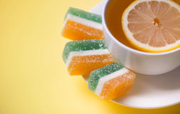 Tea with lemon and fruit jelly Royalty Free Stock Photo