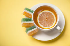 Tea with lemon and fruit jelly Royalty Free Stock Image