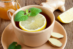Tea with lemon, ginger, honey and mint Royalty Free Stock Images