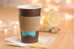 Tea with lemon and ginger in a paper cup Royalty Free Stock Photos