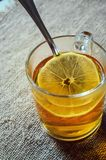 Tea with lemon in a glass royalty free stock image