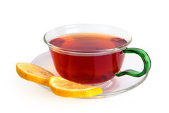 Tea with a lemon in a glass cup stock image