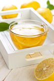 Tea with lemon in glass cup Stock Photo