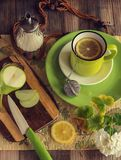 Tea with lemon in a green cup. Summer lifestyle. View above. stock photography
