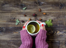 Tea with lemon in her hands. Top view Royalty Free Stock Photography