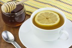 Tea lemon and honey Stock Photos