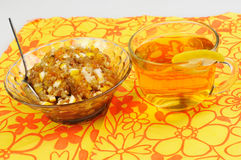 Tea with lemon. jam and dried fruits, nuts and dried apricots, h Stock Photos