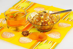 Tea with lemon. jam and dried fruits, nuts and dried apricots, h Royalty Free Stock Photo