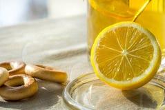 Tea with lemon. On linen tablecloths worth  lemon and a cup of tea Stock Photography