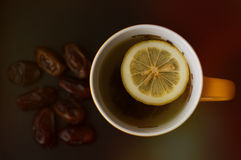 Tea with lemon and a lot of dates Stock Images