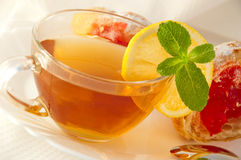 Tea with a lemon and mint Royalty Free Stock Images