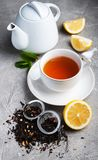 Tea with lemon and mint. On a gray stone background Royalty Free Stock Photography