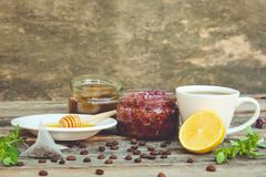 Tea, lemon, mint, jam made of rose petals, honey. Toned image Royalty Free Stock Photography