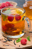Tea with lemon, mint, raspberry and cinnamon, close-up Stock Photos