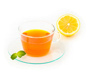 Tea with lemon and mint on white background Stock Images