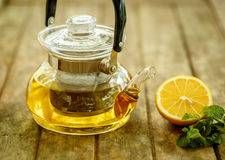 Tea with Lemon and mint on wooden board Royalty Free Stock Image