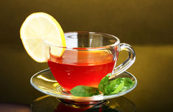 Tea with lemon and mint on yellow Royalty Free Stock Photos