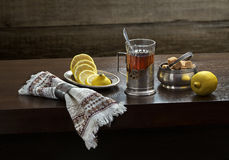 Tea, lemon, napkin, and sugar. Tea, lemon, doily and sugar in a silver bowl Stock Photography