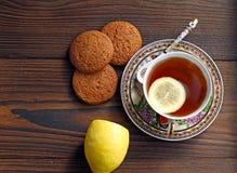 Tea with lemon. Oatmeal Cookies stock photo