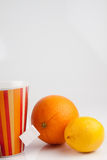 Tea with lemon and orange. Cup of tea with orange and two lemons Royalty Free Stock Photo