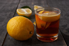 Tea with lemon and pieces of lemon Royalty Free Stock Photo