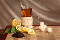 Tea, lemon and refined sugar Royalty Free Stock Images