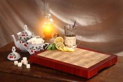 Tea, lemon and refined sugar Royalty Free Stock Image