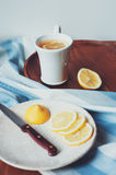 Tea with lemon slices on wooden plate, vintage toned Stock Photo