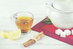 Tea with lemon and sugar. On a wooden table Stock Photo