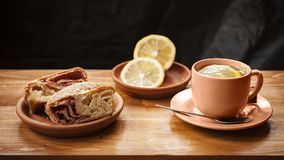 Tea with lemon. And cake on the table Royalty Free Stock Photo