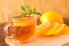 Tea with lemon. Cup of  slices and mint leaf on a rustic wooden background. Close up, Selective Focus Stock Photography