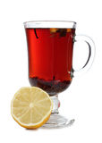 Tea and lemon three three. Glass cup with tea and lemon on white background Royalty Free Stock Image
