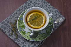 Tea with lemon and thyme Royalty Free Stock Image