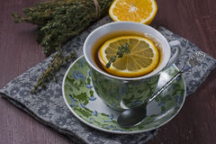 Tea with lemon and thyme Stock Images