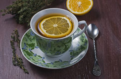 Tea with lemon and thyme Royalty Free Stock Photos