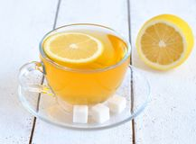 Tea with lemon in a transparent cup Royalty Free Stock Image